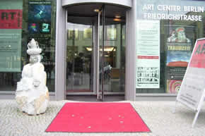 A red carpet and an African sculpture welcomed visitors to the Art Center Berlin